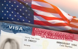 Immigration VISA United States of America. Green Card US Permanent resident for family. Work and Travel documents. US Immigrant. Embassy USA. Visa in passport. American government flag on background.