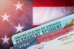 Immigration VISA United States of America. Green Card US Permanent resident. Work and Travel documents. US Immigrant. Embassy USA. Visa in passport. American government flag on background.