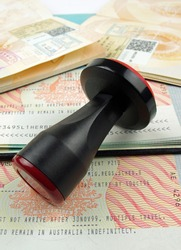 immigration visa with stamp and passport pages