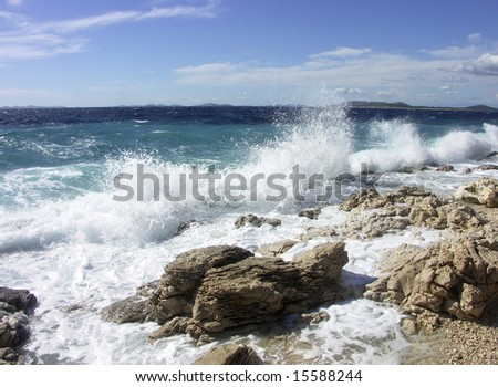Impact of large waves against rocks in the beach