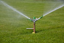 Impact sprinkler irrigating lawn of a soccer field