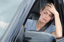 impatient female car driver stuck in traffic