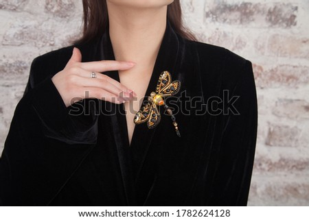 Impeccable perfect jewelry. Woman wear glamorous pin brooch. Fashion trend. Jewelry shop. Girl model long hair demonstrating golden jewelry brooch. Expensive accessory. Fashionable jewelry.