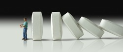 Impending doom and demise of man with pharmaceutical opioid pain medication addiction represented by huge row of pills crashing over like dominoes to eventually crush the man.
