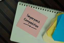 Imperfect Competition write on sticky notes isolated on Wooden Table. Selective focus on imperfect competition text
