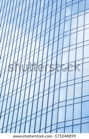 IMPERIA, ITALY - OCTOBER 2: Glass wall of office building in Milan office park in October 2, 2013.