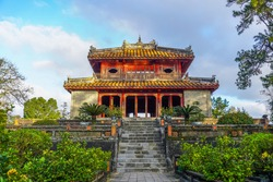 Imperial Minh Mang Tomb in Hue city, Vietnam. A UNESCO World Heritage Site. Beautiful day with blue sky. Travel and landscape concept.