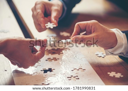 Implement improve puzzel solve connections together with synergy strategy team building organizing connection by trust communication. Hands of stakeholders business trust team holding jigsaw puzzle Сток-фото ©