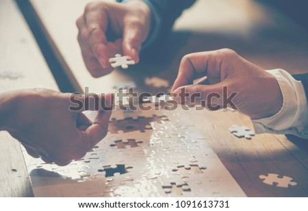 Implement improving connections together with strategy team solution by organization.Piece of jigsaw puzzle assembly. Hands of team connections together with group of business people solutions.
