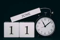 Important date and event on a black and white calendar. Cube date and month, day 11 June. Summer season.