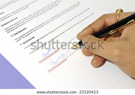 important legal lease agreement document being signed with a pen