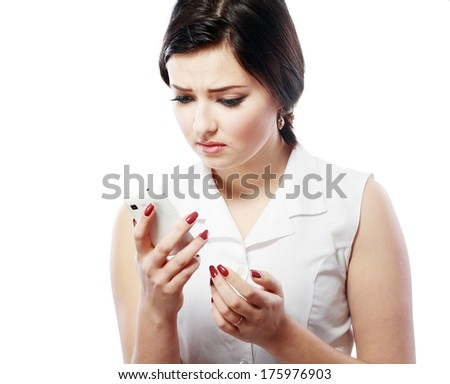 Important Text Message. Teenage girl looking concerned with a text message on her phone. Note: Not Isolated.