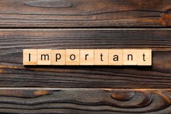 important word written on wood block. important text on wooden table for your desing, concept.
