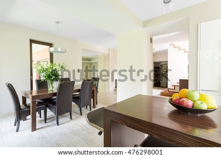 Imposing dining room in a large house with travertine floor #476298001