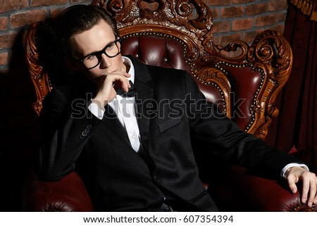 Imposing well dressed man in a classic luxurious apartments. Luxury. Men's beauty, fashion. #607354394