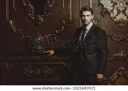 Imposing well dressed man in a luxurious apartments with classic interior. Luxury. Men