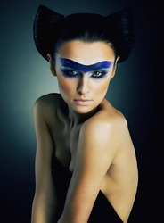 Imposing young girl with dramatic make up on her face studio shot - series of photos