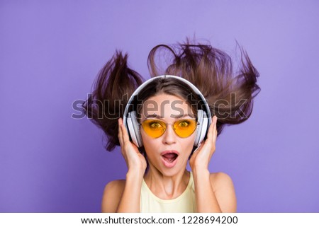 Impressed attractive beautiful good-looking adorable lady with her style spectacles she look at camera open mouth isolated on bright shine violet purple wall listen best beat track sound