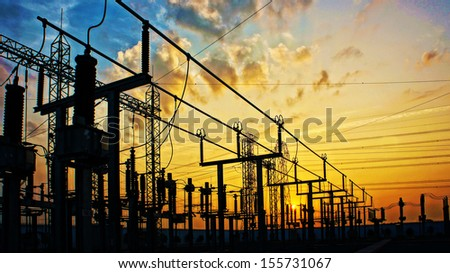 Impression network at transformer station in sunrise, high voltage up to yellow sky take with yellow tone, horizontal frame  stock photo