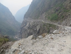 Impression of the road and surroundings of the Himalayan Annapurna Range. From Besishar to Manang (3650 mtr altitude), Nepal. On a motorbike passing landslides, waterfalls, mountain goats, snowpeaks.