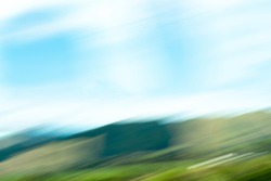 Impressionist landscape photography of New Zealand landscape for abstract, background or artistic use taken from moving train between Wellington and Auckland.