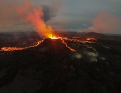 Impressive aerial View of the active volcano explosions of lava and magma rivers in Gridavik Iceland