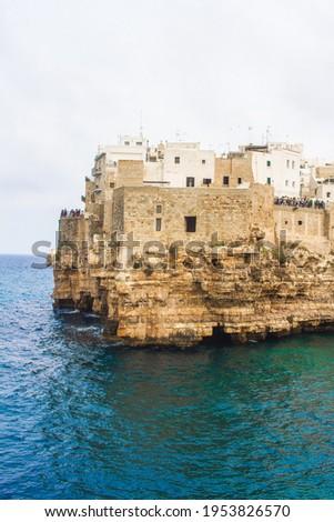 Impressive and historic White- washed Puglian Town perched atop limestones cliffs above azure water. Polignano Al Mare, Puglia  Сток-фото ©