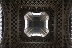 Impressive and unusual perspective of the Eiffel Tower (Paris, France), seen from directly below. Useful file for your brochure or flyer about France culture and toursim.