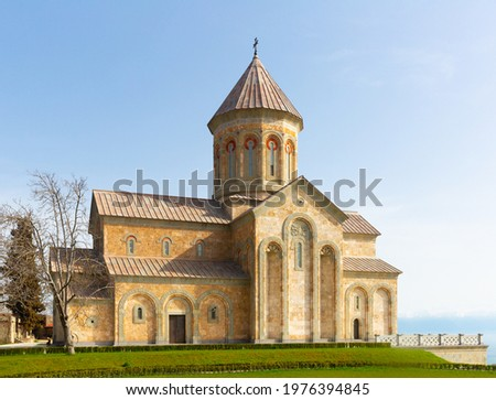 Impressive building of new Cathedral of Agia Nina at Bodbe Convent in foothills of Caucasus Mountains on sunny spring day, Kakheti, Georgia Foto stock ©