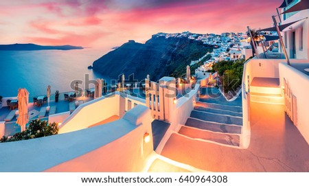 Impressive evening view of Santorini island. Picturesque spring sunset on the famous Greek resort Fira, Greece, Europe. Traveling concept background. Artistic style post processed photo.