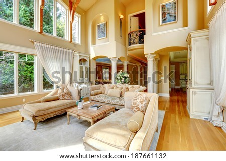 Impressive high ceiling living room antique furniture and columns #187661132