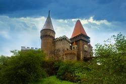 Impressive landscape with medieval Corvin Castle on elevated rock, Hunedoara, Romania