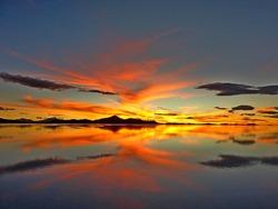 Impressive red orange sea sunset, golden romantic sundown, magical heaven clouds reflection in the salt water, spectacular surreal planet Earth, breathtaking desert nightfall. Tranquility, meditation.