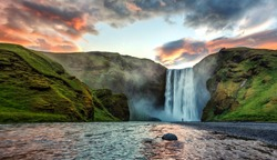 Impressive scenery of the majestic Skogafoss Waterfall of Iceland during sunrise. Amazing landscape with dramatic picturesque sky.  Iceland the most beautiful and best travel place. Beauty of World