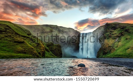 Impressive scenery of the majestic Skogafoss Waterfall of Iceland during sunrise. Amazing landscape with dramatic picturesque sky.  Iceland the most beautiful and best travel place. Beauty of World Сток-фото ©