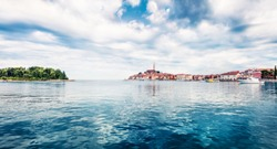 Impressive spring cityscape of Rovinj town, Croatian fishing port on the west coast of the Istrian peninsula. Colorful morning seascape of Adriatic Sea. Traveling concept background.