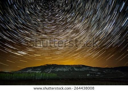 Impressive star tracks above Stenk-Izgorya protected area chalk hills in Belgorod region, southern Russia