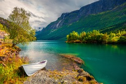Impressive summer view of Lovatnet lake, municipality of Stryn, Sogn og Fjordane county, Norway. Colorful morning scene in Norway. Beauty of nature concept background.