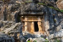 Impressive view of tombs carved in crag in ancient Lycian city of Pinara in Turkey