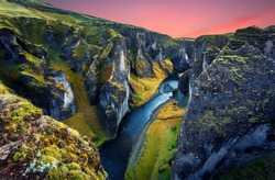 Impressively beautiful nature of Iceland. Canyon Fjadrargljufur  is one famous natural landmark and travel destination place. Tipical Icelandic scenery during sunset. Dramatic Scenery of Iceland.