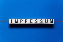 Impresssum - Imprint word concept on cubes