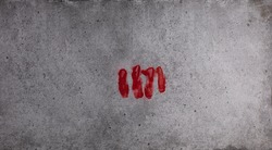 imprint of a bloody fist on cement