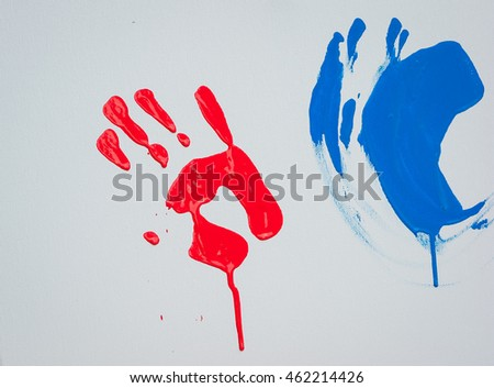 Imprint of child's palm by a red paint on a white canvas - Shutterstock ID 462214426