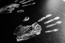 Imprint of human hands,black background