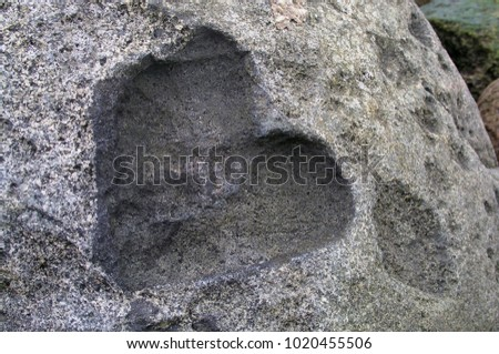 Imprint of the heart in the stone. An imprint of the heart, on the seashore. #1020455506