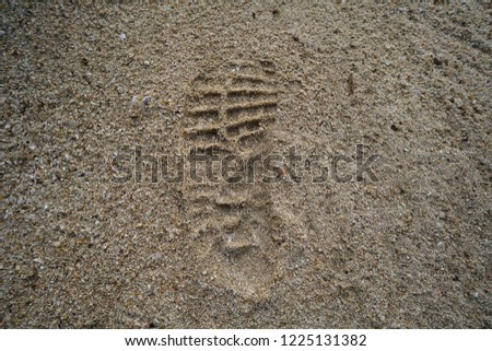 Imprint of the shoe on sand grain #1225131382
