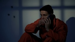 Imprisoned male making phone call, prison rules violation, gadget prohibition