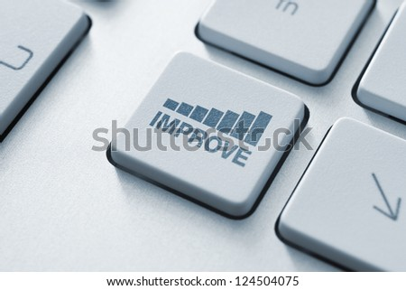 Improve button on the keyboard. Motivational concept. Toned Image.