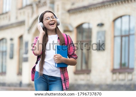 Improve your spoken English. Happy kid listen and speak English. Listening and speaking. Speak fluent and confident English. Learning foreign language. Online courses. Speak more fluently, copy space. Stock photo ©
