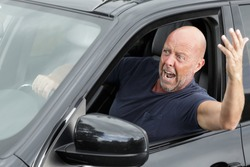 impulsive and energetic mature man shouting out of the window